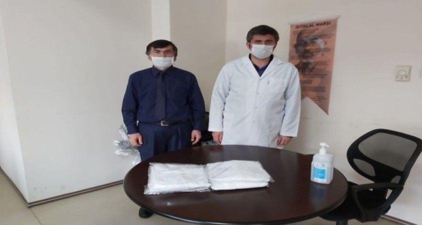 Salihli TSO'dan sağlık çalışanlarına koruyucu tulum desteği